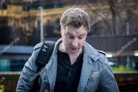 Former police officer, Richard Williams leaves Southward Crown Court in London after receiving a two year suspended sentence after being convicted of fraud