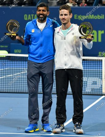 Wesley Koolhof of the Netherlands (R) and Rohan Bopanna  of India pose with their trophies after winning the doubles final match against Luke Bambridge  of Britain and Santiago Gonzalez Mexico at the ATP Qatar Open Tennis tournament in Doha, Qatar, 10 January 2020.