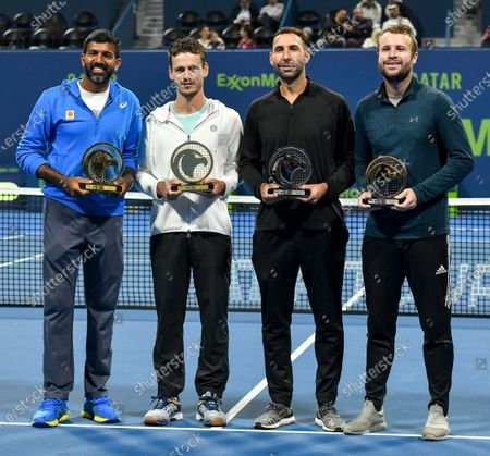 Wesley Koolhof of the Netherlands (2-L) and Rohan Bopanna (L) of India pose with their trophies after winning the doubles final match against Luke Bambridge  of Britain and Santiago Gonzalez Mexico at the ATP Qatar Open Tennis tournament in Doha, Qatar, 10 January 2020.