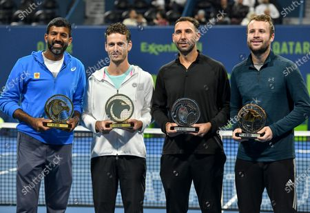 Stock Photo of Wesley Koolhof of the Netherlands (2-L) and Rohan Bopanna (L) of India pose with their trophies after winning the doubles final match against Luke Bambridge  of Britain and Santiago Gonzalez Mexico at the ATP Qatar Open Tennis tournament in Doha, Qatar, 10 January 2020.