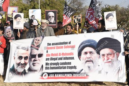 Pakistani Shi'ite Muslims hold pictures of General Qasem Soleimani, the slain head of Iran's Islamic Revolutionary Guard Corps' elite Quds Force, during a protest against the USA, in Islambad, Pakistan, 10 January 2020. General Qasem Soleimani, was killed in an airstrike on 03 January, in Baghdad ordered by the United States president, the Pentagon said. General Soleimani was in charge of Iran's foreign policy strategy as the head of the Quds Force, an elite wing of the Islamic Revolutionary Guard Corps, which the US designated as a terror organization. The Quds Force holds sway over a raft of Shia militias across the region, from Lebanon to Syria and Iraq.