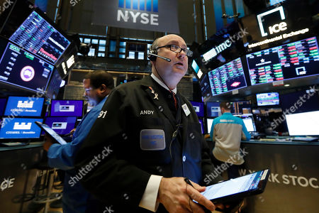 Stock Image of Trader Andrew Silverman works on the floor of the New York Stock Exchange, . Stocks are off to a mixed start on Wall Street after the government reported that U.S. employers eased back on hiring last month