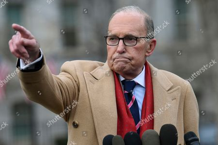 White House economic adviser Larry Kudlow speaks with reporters outside the West Wing of the White House in Washington