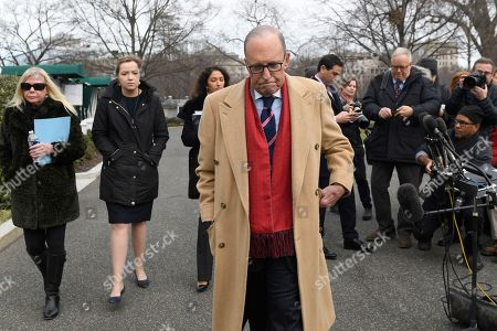 White House economic adviser Larry Kudlow walks back to the West Wing of the White House in Washington, after speaking to reporters