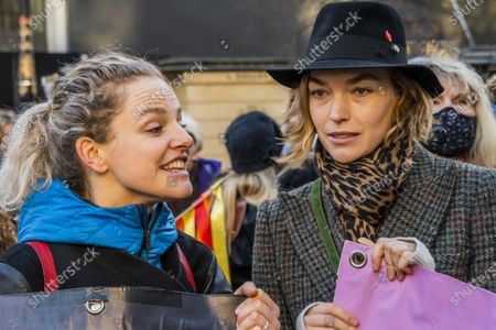 Arizona Muse, British-American fashion model, joins the protest blocking the road temporarily and chats to Climate activist Tamsin Omond - Extinction rebellion gather outside the Australian High Commission, on the Aldwych, to protest about the attitude of the Australian Government to climate change, in general, and the forest fires (and their wider impact), in particular.