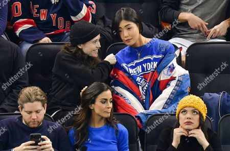 Elliot Page and guest attend New Jersey Devils vs New York Rangers game at Madison Square Garden