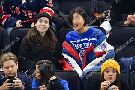 Stock Picture of Elliot Page and guest attend New Jersey Devils vs New York Rangers game at Madison Square Garden