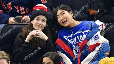 Stock Photo of Elliot Page and guest attend New Jersey Devils vs New York Rangers game at Madison Square Garden