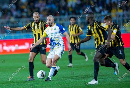 Al-Nassr's Nordin Amrabat (C) in action against Al-Ittihad's Karim EL Ahmadi (L) And Al-Ittihad's Mansour Al Harbi (R) during the Saudi Professional League soccer match between Al-Nassr and Al-Ittihad at Prince Faisal bin Fahd Stadium, Al-Ridah, Saudi Arabia, 10 January 2020.