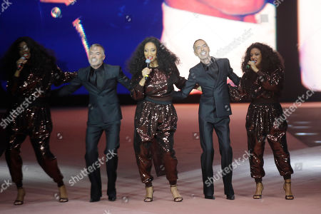 Dean Caten, Dan Caten, Sister Sledge. Designers Dean Caten and Dan Caten accept applause as they are joined by members of the band Sister Sledge, at the end of the Dsquared2 men's Fall-Winter 2020/21 collection, that was presented in Milan, Italy