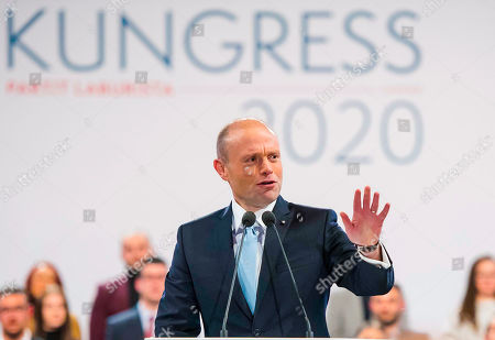 Malta's Prime Minister Joseph Muscat waives during his farewell speech as Labour Party leader in Kordin, near Valletta, . A new leader will be elected during the weekend