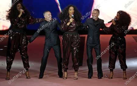 Italian designers Dean and Dan Caten perform with members of US group Sister Sledge after the show of the brand Dsquered2 during the Milano Fashion Week Men's, in Milan, Italy, 10 January 2020. The Fall-Winter 2020-21 men's collections are presented at the Milano Moda Uomo from 10 to 14 January.