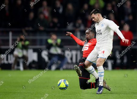 Marseille's Nemanja Radonjic, right, duels for the ball with Rennes' M'Baye Niang during the League One soccer match between Rennes and Marseille, at the Roazhon Park stadium in Rennes, France
