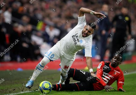 Marseille's Dimitri Payet, front, duels for the ball with Rennes' Hamari Traore during the League One soccer match between Rennes and Marseille, at the Roazhon Park stadium in Rennes, France