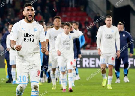 Stock Photo of Marseille's Dimitri Payet, left, celebrates at the end of the League One soccer match between Rennes and Marseille, at the Roazhon Park stadium in Rennes, France