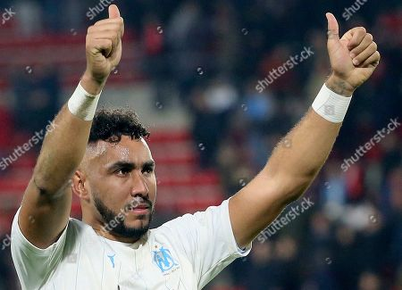 Marseille's Dimitri Payet celebrates at the end of the League One soccer match between Rennes and Marseille, at the Roazhon Park stadium in Rennes, France
