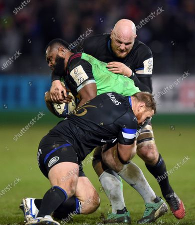 Vereniki Goneva of Harlequins is double-tackled by Ross Batty and Matt Garvey of Bath Rugby