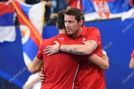 Stock Photo of Novak Djokovic of Serbia (L) embraces Russia team captain Marat Safin (R) after defeating Danil Medvedev of Russia during their semi-final match on day nine of the ATP Cup tennis tournament at Ken Rosewall Arena in Sydney, Australia, 11 January 2020.