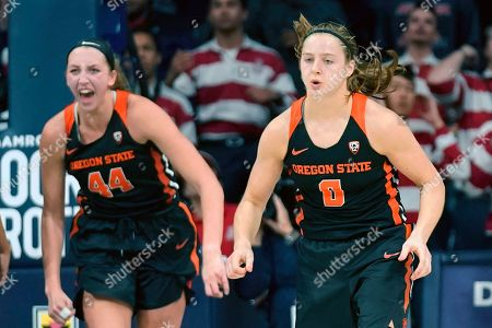 Oregon State guard Mikayla Pivec (0) and forward Taylor Jones react to Pivec's go-ahead jumper in the final seconds of the team's NCAA college basketball game against Arizona, in Tucson, Ariz. Oregon State won 63-61