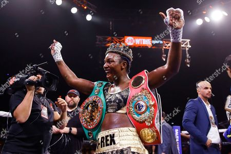 Claressa Shields, Ivana Habazin. Claressa Shields poses for photographs after defeating Ivana Habazin in their 154-pound title boxing bout in Atlantic City, N.J