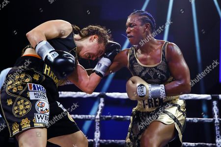 Claressa Shields, Ivana Habazin. Claressa Shields, right, punches Ivana Habazin during the seventh round of a women's 154-pound title boxing bout in Atlantic City, N.J