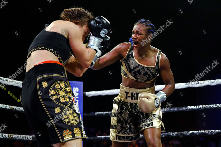 Stock Image of Claressa Shields, Ivana Habazin. Claressa Shields, right, punches Ivana Habazin during the eighth round of a women's 154-pound title boxing bout in Atlantic City, N.J