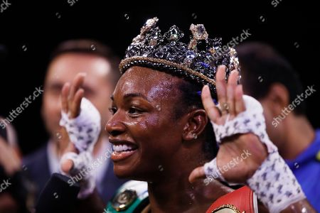 Stock Photo of Claressa Shields poses for photographs after defeating Ivana Habazin in their 154-pound title boxing bout in Atlantic City, N.J