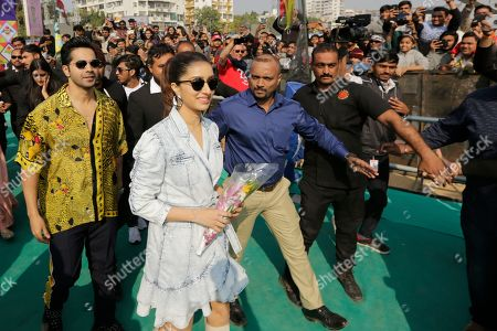 "Bollywood actors Varun Dhawan, left, and Shraddha Kapoor arrive to promote their upcoming movie ""Street Dancer 3"" in Ahmadabad, India, . The movie will be released on Jan. 24"