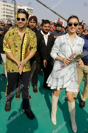 """Bollywood actors Varun Dhawan, left and Shraddha Kapoor arrive to promote their upcoming movie """"Street Dancer 3"""" in Ahmadabad, India, . The movie will be released on Jan. 24"""
