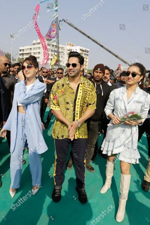 """Bollywood actors Varun Dhawan, center, Shraddha Kapoor, right, and Nora Fatehi arrive to promote their upcoming movie """"Street Dancer 3"""" in Ahmadabad, India, . The movie will be released on Jan. 24"""