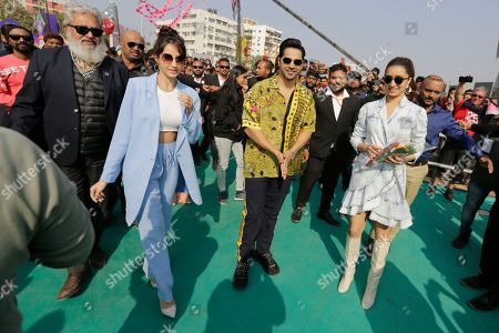 "Bollywood actors Varun Dhawan, center, Shraddha Kapoor, right, and Nora Fatehi arrive to promote their upcoming movie ""Street Dancer 3"" in Ahmadabad, India, . The movie will be released on Jan. 24"