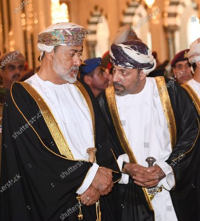 Oman's new Sultan, Haitham bin Tariq Al Said (L) speaks to Oman's Interior Minister Sayyid Hamoud bin Faisal al-Busaidi during the funeral of the Sultan of Oman, Qaboos bin Said Al Said, in Muscat, Oman, 11 January 2020. According to media reports, Qaboos, who had been serving as Sultan of Oman since 1970, died earlier in the day.