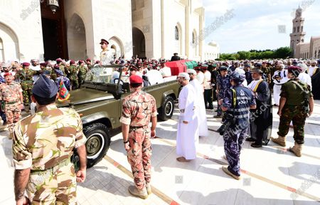 Officials stand next to a vehicle with the coffin during the funeral of the Sultan of Oman, Qaboos bin Said Al Said, in Muscat, Oman, 11 January 2020. According to media reports, Qaboos, who had been serving as Sultan of Oman since 1970, died earlier in the day.