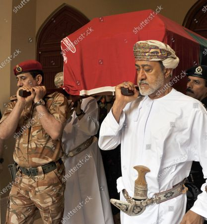Oman's new Sultan, Haitham bin Tariq Al Said (R) carries the coffin of late Sultan of Oman, Qaboos bin Said Al Said during the funeral in Muscat, Oman, 11 January 2020. According to media reports, Qaboos, who had been serving as Sultan of Oman since 1970, died earlier in the day.
