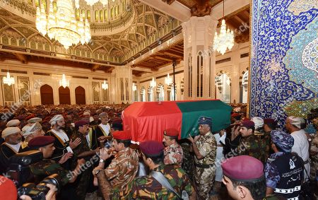 In this photo made available by Oman News Agency, people carry the coffin of Oman's Sultan Qaboos bin Said, at Sultan Qaboos Grand Mosque in Muscat, Oman, . Sultan Qaboos bin Said, the Mideast's longest-ruling monarch who seized power in a 1970 palace coup and pulled his Arabian sultanate into modernity while carefully balancing diplomatic ties between adversaries Iran and the U.S., has died. He was 79