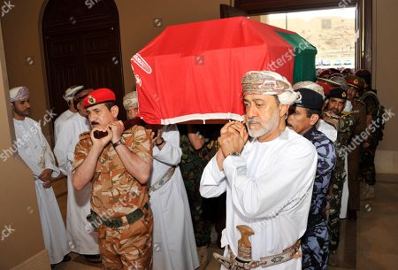In this photo made available by Oman News Agency, Oman's new sultan Haitham bin Tariq Al Said, right, carries the Sultan Qaboos' coffin at Sultan Qaboos Grand Mosque in Muscat, Oman, . Sultan Qaboos bin Said, the Mideast's longest-ruling monarch who seized power in a 1970 palace coup and pulled his Arabian sultanate into modernity while carefully balancing diplomatic ties between adversaries Iran and the U.S., has died. He was 79