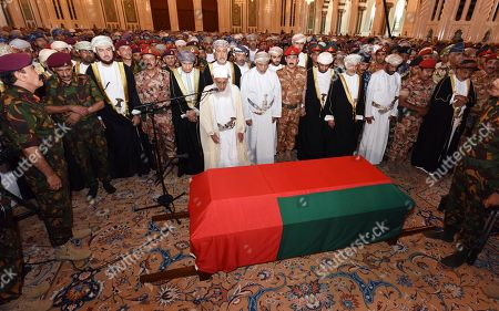 In this photo made available by Oman News Agency, Oman's new sultan Haitham bin Tariq Al Said, center behind the Imam, attends the prayer ceremony for Sultan Qaboos' coffin at Sultan Qaboos Grand Mosque in Muscat, Oman, . Sultan Qaboos bin Said, the Mideast's longest-ruling monarch who seized power in a 1970 palace coup and pulled his Arabian sultanate into modernity while carefully balancing diplomatic ties between adversaries Iran and the U.S., has died. He was 79
