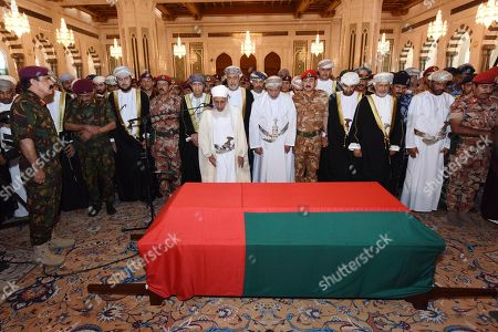 In this photo made available by Oman News Agency, Oman's new sultan Haitham bin Tariq Al Said, centre behind the Imam, attends the prayer ceremony for Sultan Qaboos' coffin at Sultan Qaboos Grand Mosque in Muscat, Oman, . Sultan Qaboos bin Said, the Mideast's longest-ruling monarch who seized power in a 1970 palace coup and pulled his Arabian sultanate into modernity while carefully balancing diplomatic ties between adversaries Iran and the U.S., has died. He was 79