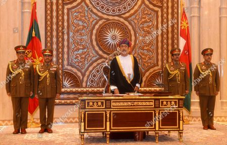 In this photo made available by Oman News Agency, Oman's new sultan Haitham bin Tariq Al Said, swears in at the Royal Family Council in Muscat, Oman, . Sultan Qaboos bin Said, the Mideast's longest-ruling monarch who seized power in a 1970 palace coup and pulled his Arabian sultanate into modernity while carefully balancing diplomatic ties between adversaries Iran and the U.S., has died. He was 79