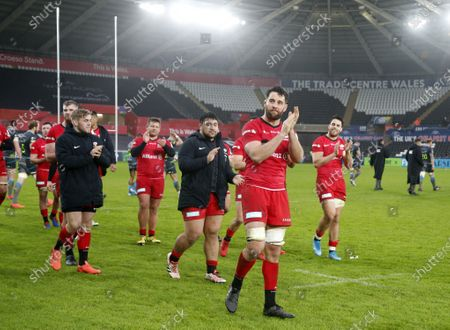 Calum Clark leads the Saracens players in applauding the fans after the game