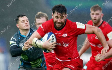 Calum Clark of Saracens is tackled by Shaun Venter of Ospreys