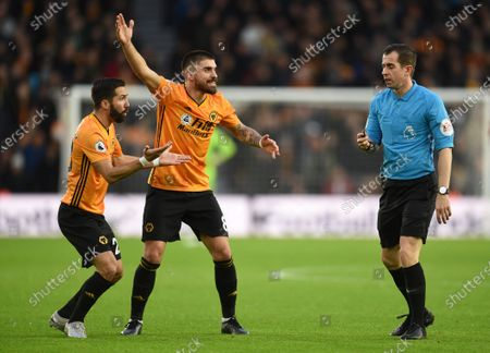Ruben Neves of Wolverhampton Wanderers and Joao Moutinho of Wolverhampton Wanderers react to Referee Peter Bankes in protest of assistant referee Sian Massey - Ellis decision.