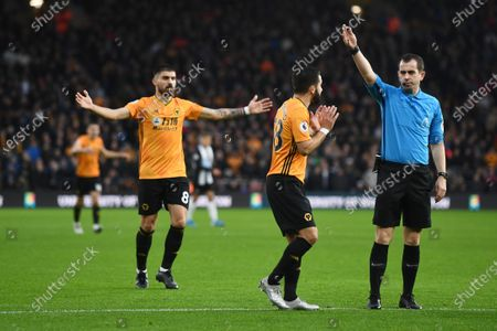 Stock Picture of Joao Moutinho of Wolverhampton Wanderers and Ruben Neves of Wolverhampton Wanderers plead with Referee Peter Bankes.