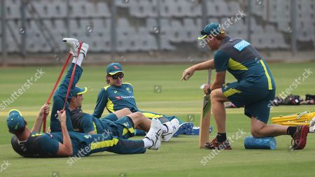 Australia's cricket coach Andrew McDonald, right, speaks with players during a training session ahead of their first one-day international cricket match against India in Mumbai, India