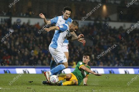 Bradley Johnson of Blackburn Rovers  is tackled by Joe Rafferty of Preston North End  during the EFL Sky Bet Championship match between Blackburn Rovers and Preston North End at Ewood Park, Blackburn