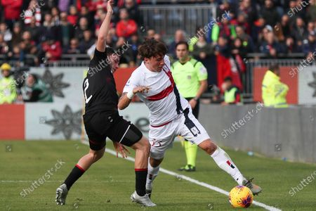 Cagliari's Luca Pellegrini (R) and Milan's Davide Calabria (L) in action during the Italian Serie A soccer match between Cagliari Calcio and AC Milan at Sardegna Arena stadium in Cagliari, Italy,11 January 2020.