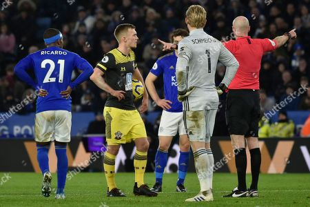 Southampton's James Ward-Prowse, reacts as the referee Lee mason listens to the VAR referee who said that Southampton's Shane Long was offside when fouled by Leicester's Caglar Soyuncu, so no penalty is given during the English Premier League soccer match between Leicester City and Southampton at the King Power stadium in Leicester, England