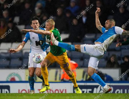 Stock Photo of Jayden Stockley of Preston North End challenged by Bradley Johnson of Blackburn Rovers