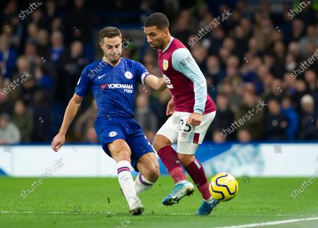Aaron Lennon of Burnley is tackled by Cesar Azpilicueta of Chelsea