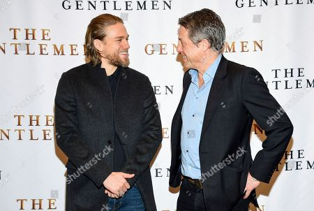"Charlie Hunnam, Hugh Grant. Actors Charlie Hunnam, left, and Hugh Grant pose together during photo call for the film ""The Gentlemen"" at The Whitby Hotel, in New York"